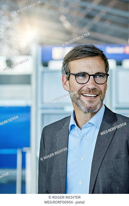 Smiling businessman at the airport