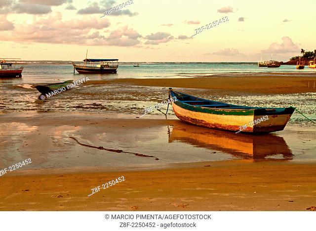 Fishing boats resting on the sand. Itacare, Bahia, Brazil