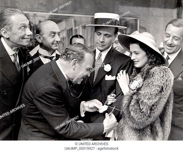 Weihnachten im Juli, (CHRISTMAS IN JULY) USA 1940 s/w, Regie: Preston Sturges, DICK POWELL, ELLEN DREW, Key: Pelzmantel, Einkauf, Label