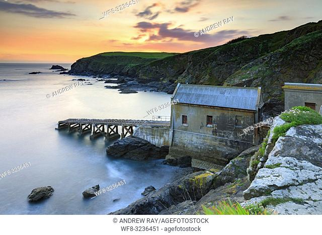 Sunset captured in March from Lizard Point in Cornwall, with the old lifeboat station as the main focal point. . A long shutter speed was utilized to blur the...