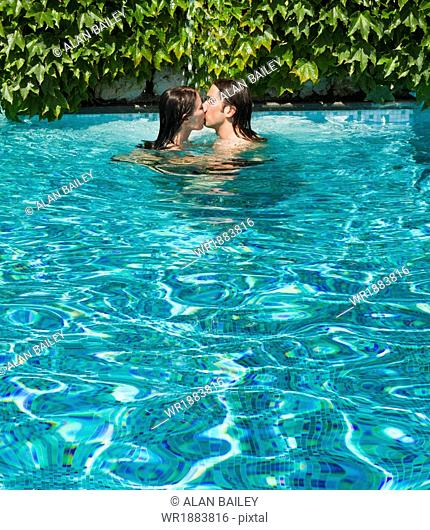 Italy, Ravello, Couple kissing in swimming pool