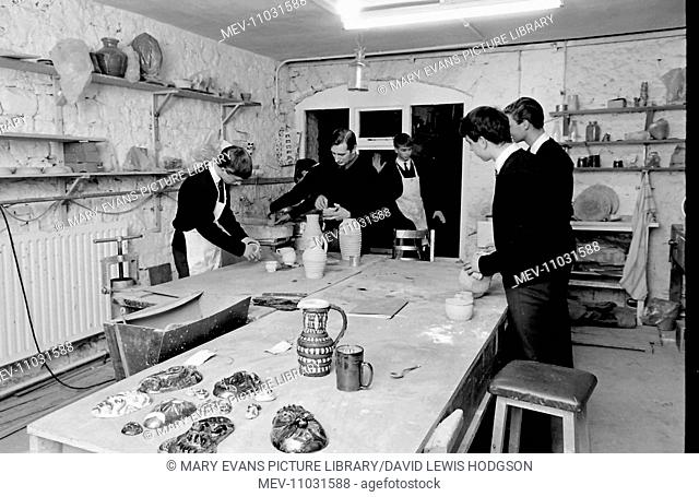 Schoolboys and teachers at work in a pottery class at Atlantic College (United World College of the Atlantic), St Donat's Castle, Llantwit Major, Glamorgan