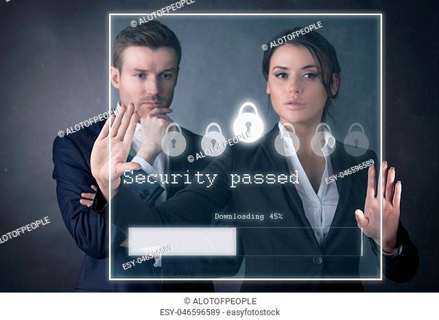 Business people enter security password