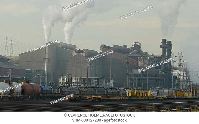 CLEVELAND - SEPTEMBER 28: Steam rises from the smokestacks of the Arcelo Mittal steel mill in the Flats area on September 28, 2014 in Cleveland, Ohio