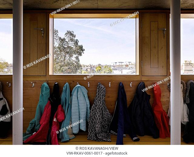 Cloakroom with window view and coats. Inchicore Model School, Inchicore, Ireland. Architect: Donaghy and Dimond Architects, 2015