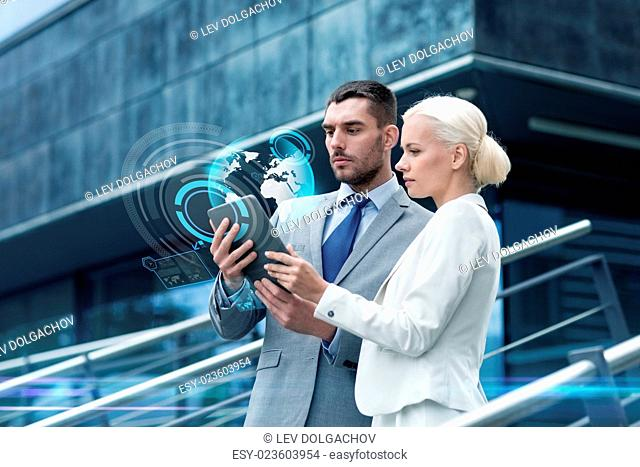 business, partnership, technology and people concept - businessman and businesswoman working with tablet pc computer and globe hologram on city street