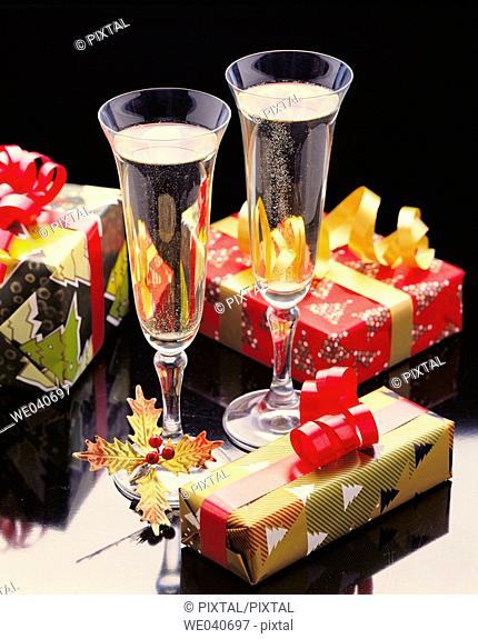 Champagne glasses and Christmas gifts