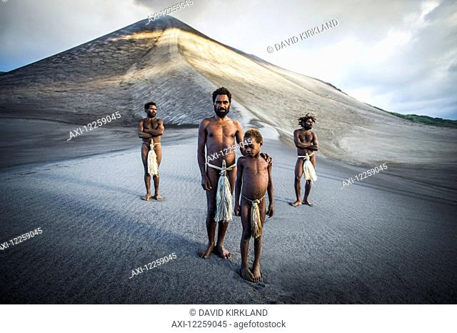 A group of ni-Vanuatu men from the local village gather at the base of Yasur Volcano; Tanna Island, Vanuatu