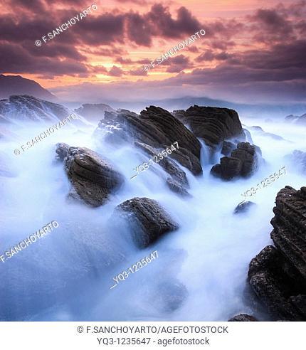 Waves breaking against the coast in Cerdigo, Castro Urdiales, Cantabria, Spain