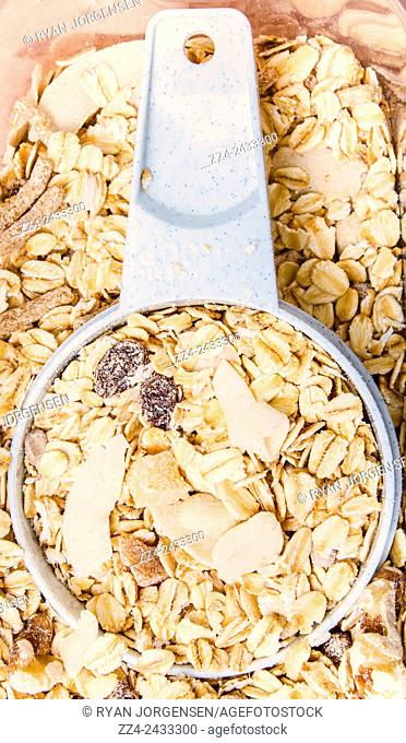 Food still life closeup photo on a cup serving of Muesli containing dried fruits, nuts, roll oats and bran