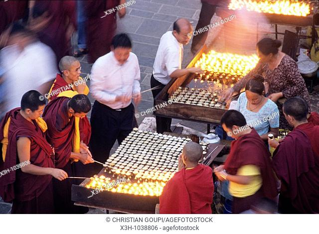 light offerings at Bodnath Temple,Nepal,Himalaya,South Asia
