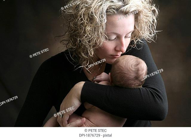 A Mother Holding Her Newborn Baby