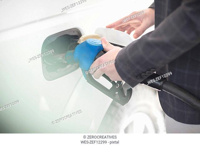 Man fueling car