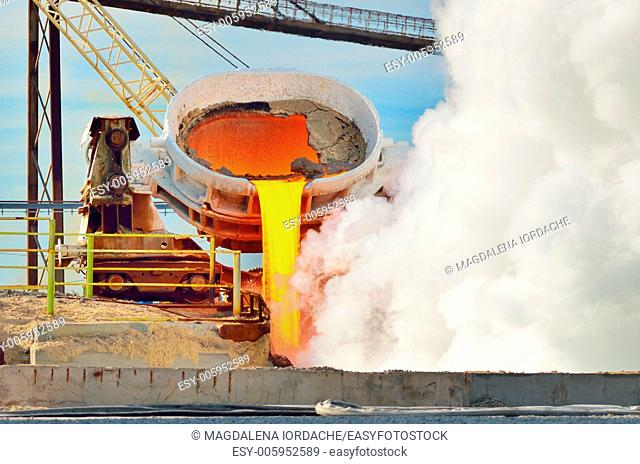hot steel pouring in steel plant. Production of cast iron in steel mills