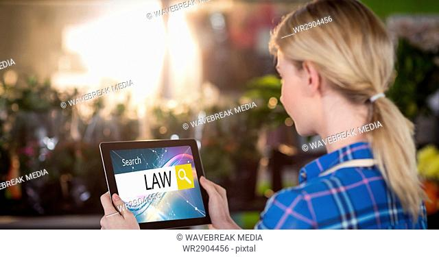 Female student searching for law studies on tablet PC