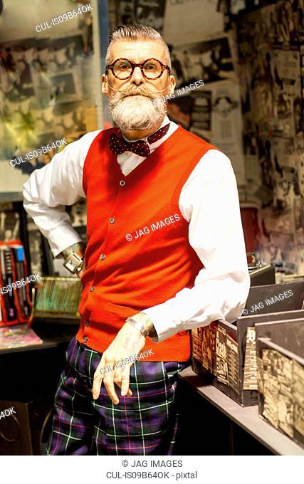 Portrait of quirky vintage senior man in vintage record shop