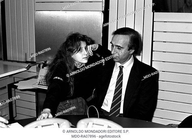 Italian TV host Pippo Baudo (Giuseppe Raimondo Vittorio Baudo) spending time with his daughter Tiziana during the break of a TV show. Italy, 1982