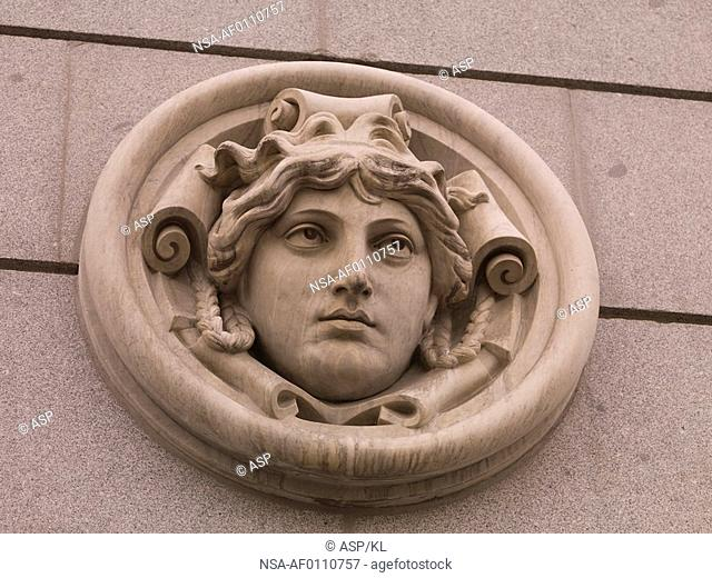 Carved face on building in Madrid