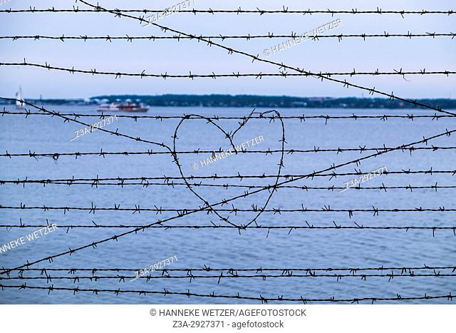 A heart in barbed wire at the sea in Tallinn, Estonia, Europe