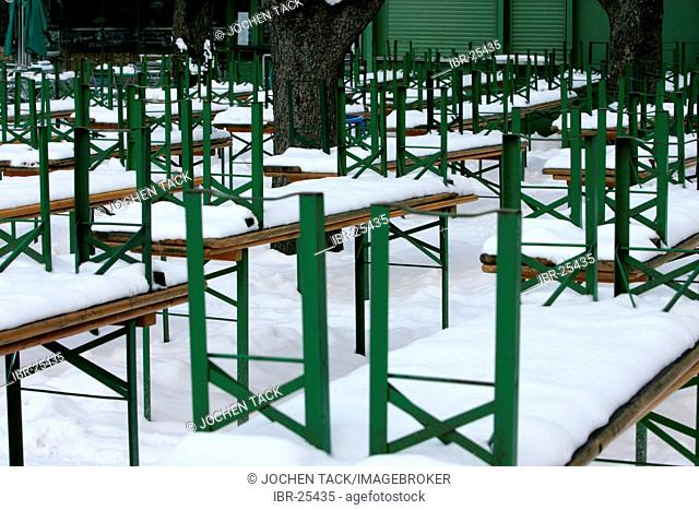 DEU, Germany, Munich : Snow covered beergarden tables at the Viktualien market in the city center