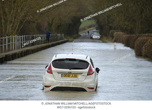 UK Felmersham -- 09 Feb 2014 -- A Ford car stranded in the floodwaters of the Great River Ouse in Felmersham Bedfordshire England UK -- Picture by Jonathan...