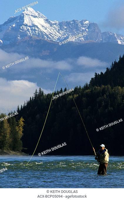 Flyfisherman on Skeena river, near Kitwanga, British Columbia, Canada