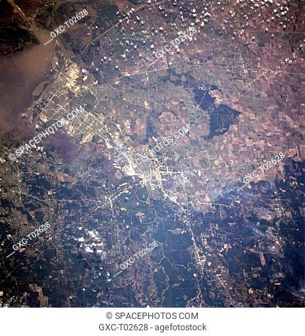 Beaumont and Port Arthur, Texas, USA April 1998 An extensive highway network light colored lines provides ground linkage between the cities of Beaumont near the...