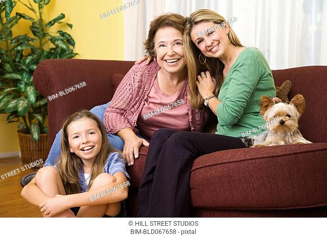 Hispanic grandmother, mother and daughter bonding