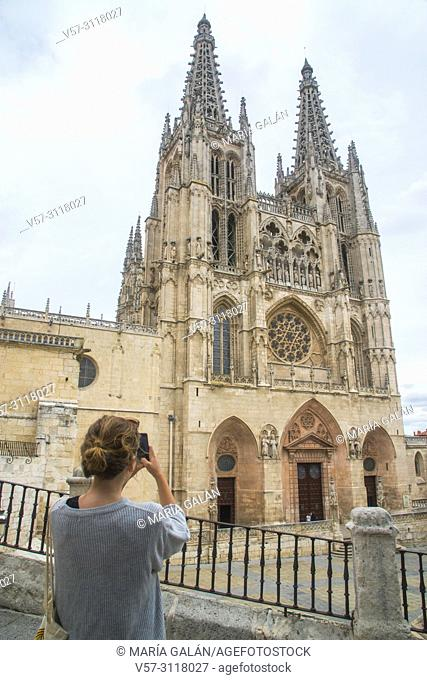 Tourist taking photos of the Gothic cathedral. Burgos, Spain