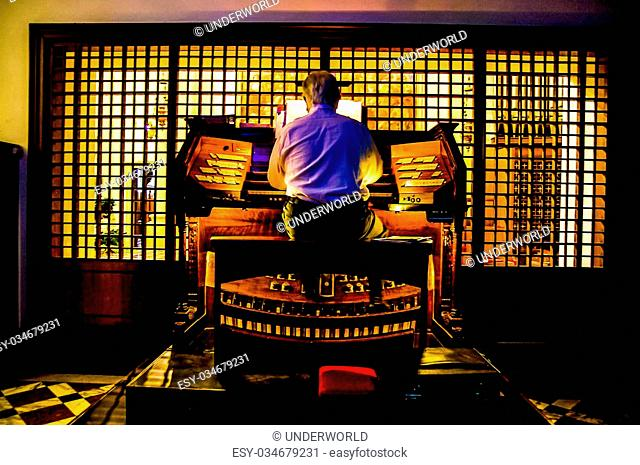 Close up Wiew of a Organist Playing a Organ