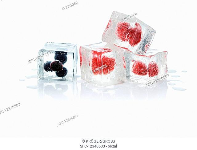 Ice cubes with blueberries and raspberries