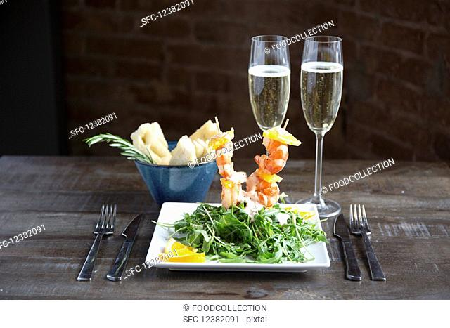 Prawn skewers with rocket, orange and cocktail sauce