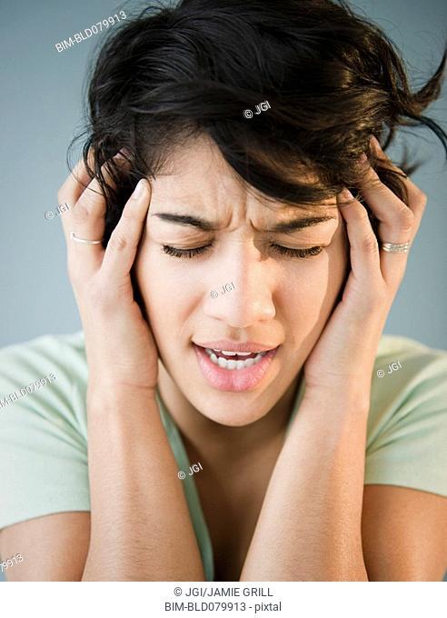 Hispanic woman with headache