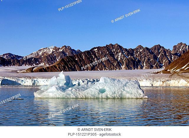 Calved iceberg from the Lilliehöökbreen glacier drifting in the Lilliehöökfjorden, fjord branch of Krossfjorden in Albert I Land, Spitsbergen, Svalbard, Norway