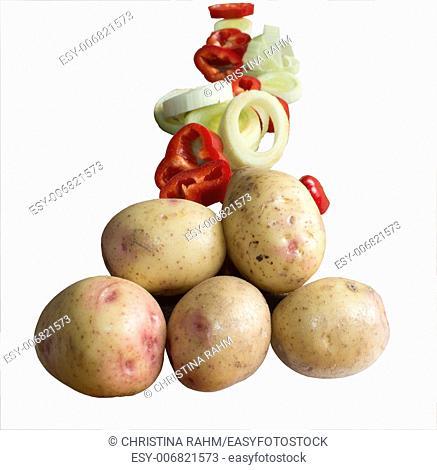 Potato paprika onion pyramid isolated on white