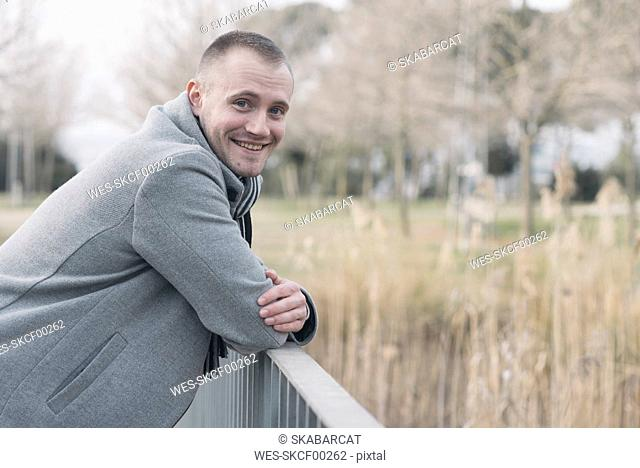 Portrait of smiling man relaxing in a park