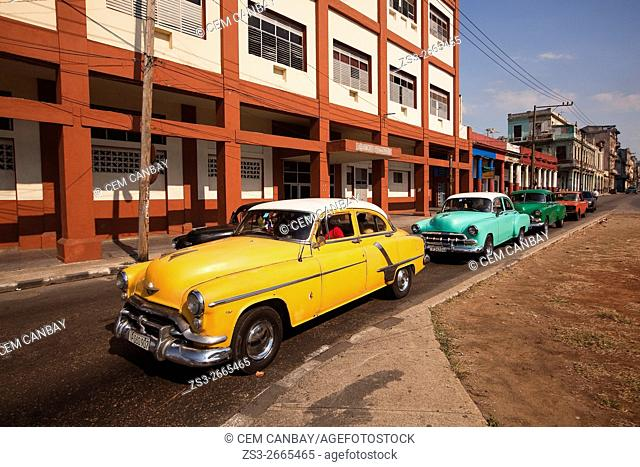 Colorful old American cars used as taxis in Vedado district in Havana, La Habana, Cuba, Central America