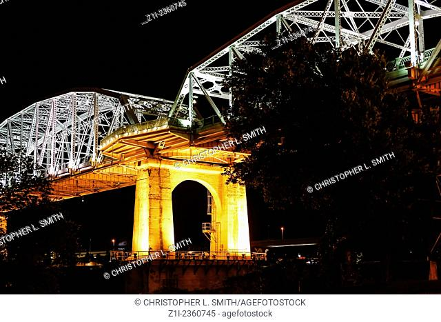 The Shelby Ave Pedestrian Bridge over the Cumberland River at night in Nashville TN