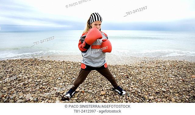 Boxer girl training on the beach, Spain