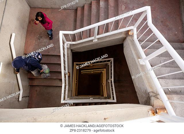 Two people descending a staircase in downtown Brampton, Ontario, Canada