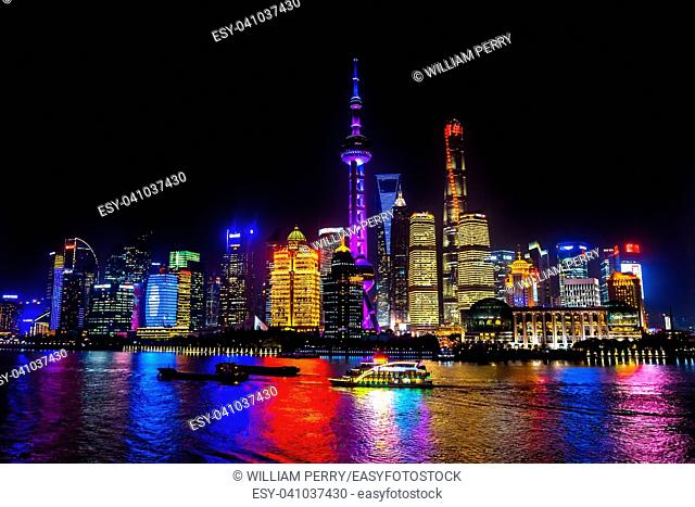 Oriental Pearl TV Tower Pudong Boats Reflections Nights Lights Huangpu River Three Skyscrapers Cityscape Shanghai China