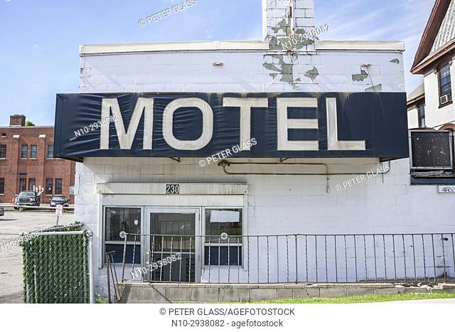 """""""""""Motel"""" sign on an old, abandoned motel"