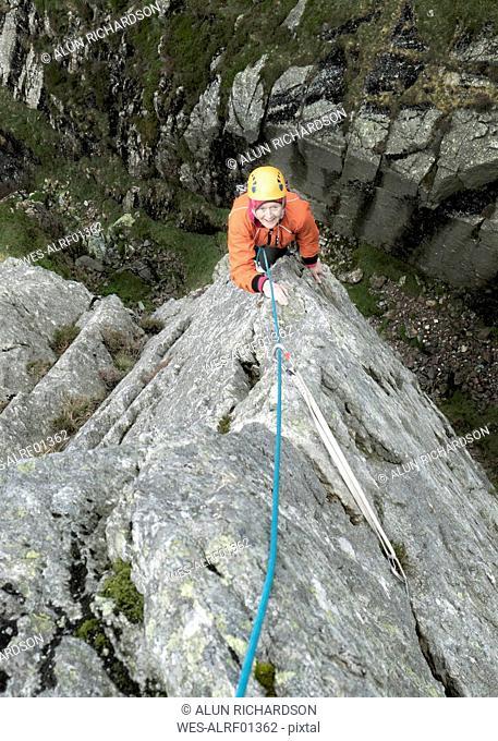 England, Langdale Valley, Gimmer Crag, female climber on rock