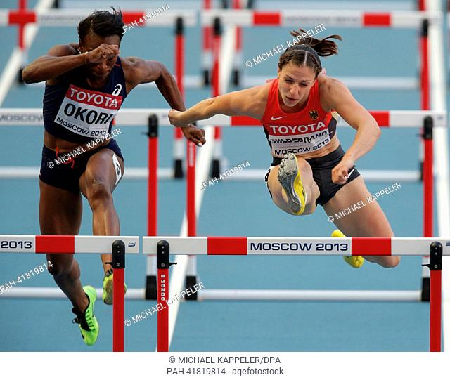 Nadine Hildebrand (R)of Germany and Reina-Flor Okori of France in the Women's 100m Hurdles Semi-Final at the 14th IAAF World Championships in Athletics at...
