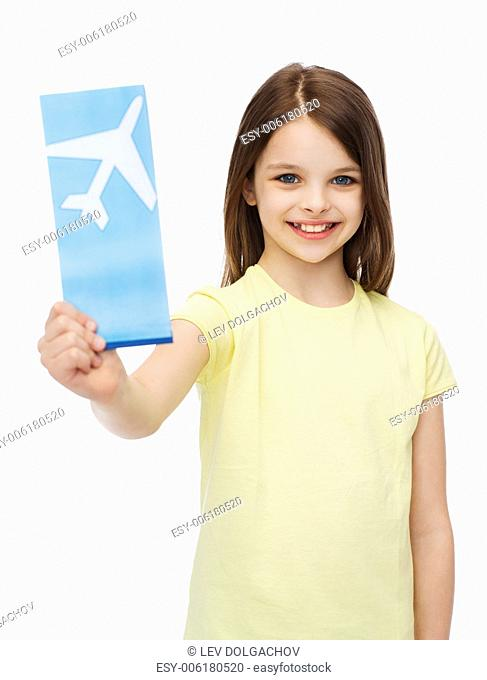 travel, holiday, vacation, childhood and transportation concept - smiling little girl with airplane ticket