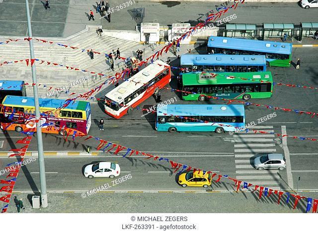 High angle view at busses at Taksim square, Taksim Cumhuriyet Abidesi, Istanbul, Turkey, Europe