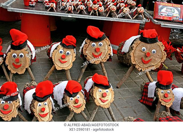 Tions de Nadal (Christmas logs) for sale at Christmas market. Typical Catalan tradition