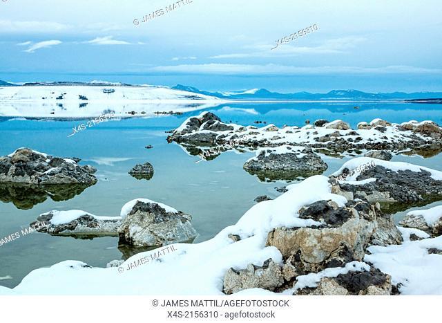 Snow covers the rocky shoreline of Mono Lake in California's Eastern Sierra region