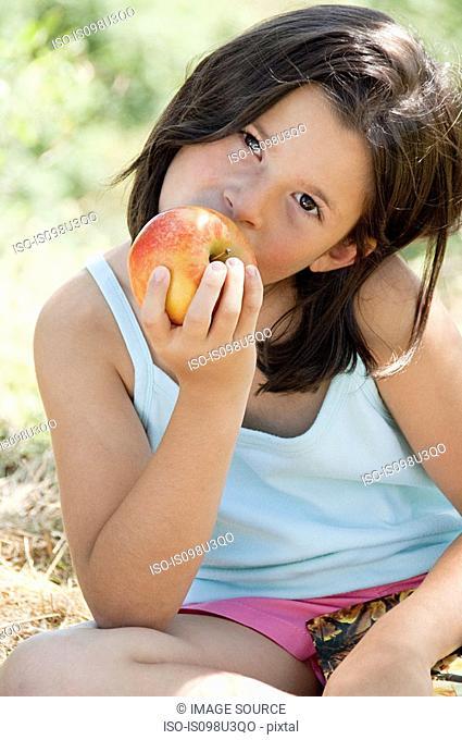 Girls eating apple