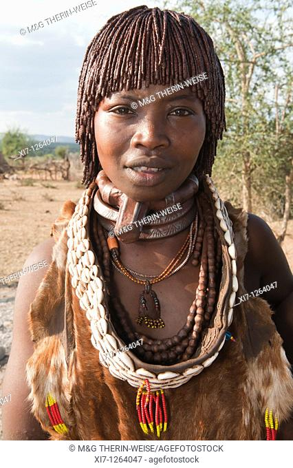 Young Hamar woman wearing necklaces made of Cowry shells, Omo river valley, Southern Ethiopia